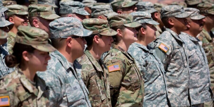 """TOPSHOT - Members of the Arizona National Guard listen to instructions on April 9, 2018, at the Papago Park Military Reservation in Phoenix. - Arizona deployed its first 225 National Guard members to the Mexican border on Monday after President Donald Trump ordered thousands of troops to the frontier region to combat drug trafficking and illegal immigration. """"The Arizona National Guard will deploy 225 members of the Guard today to support border security measures,"""" the state militia said in a statement. (Photo by Caitlin O'Hara / AFP)        (Photo credit should read CAITLIN O'HARA/AFP via Getty Images)"""